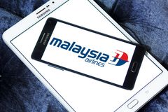 Malaysia Airlines logo. Logo of Malaysia Airlines on samsung mobile. Malaysia Airlines is the flag carrier of Malaysia and a member of the oneworld airline Royalty Free Stock Photography
