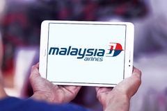 Malaysia Airlines logo. Logo of Malaysia Airlines on samsung tablet . Malaysia Airlines is the flag carrier of Malaysia and a member of the oneworld airline Royalty Free Stock Images
