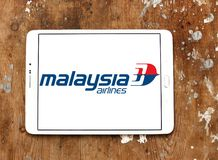 Malaysia Airlines logo. Logo of Malaysia Airlines on samsung tablet on wooden background. Malaysia Airlines is the flag carrier of Malaysia and a member of the Royalty Free Stock Images