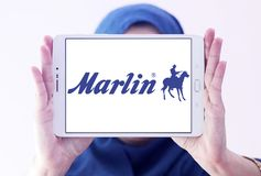 Marlin Firearms logo. Logo of Marlin Firearms on samsung tablet holded by arab muslim woman. Marlin Firearms is a manufacturer of semi automatic, lever action Stock Photography