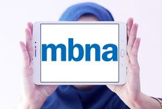 MBNA Corporation logo. Logo of MBNA Corporation on samsung tablet holded by arab muslim woman. MBNA Corporation is a bank holding company and parent company of Royalty Free Stock Photography