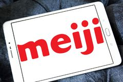Meiji Holdings logo. Logo of Meiji Holdings company on samsung tablet . the Meiji Group offers a wide range of products including confectioneries, dairy goods Royalty Free Stock Image