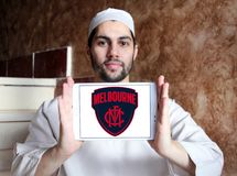 Melbourne Football Club logo. Logo of Melbourne Football Club on samsung tablet holded by arab muslim man. The Melbourne Football Club, nicknamed the Demons, is Stock Images