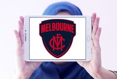 Melbourne Football Club logo. Logo of Melbourne Football Club on samsung tablet holded by arab muslim woman. The Melbourne Football Club, nicknamed the Demons Stock Photography