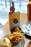 Logo, menu, hamburger et pommes frites du ` s de Nando placés sur le Tableau Photographie stock libre de droits