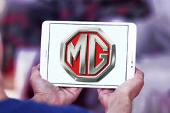MG Motor company logo. Logo of MG Motor company on samsung tablet. MG Motor UK Limited MG Motor is an automotive company headquartered in Longbridge, Birmingham Stock Photo