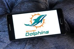 Miami Dolphins american football team logo. Logo of Miami Dolphins american football team on samsung mobile. The Miami Dolphins are a professional American Stock Photos