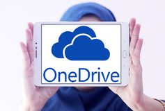OneDrive logo. Logo of microsoft onedrive on samsung tablet holded by arab muslim woman . it is a file-hosting service operated by Microsoft as part of its suite Stock Image