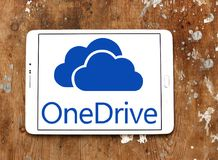 OneDrive logo. Logo of microsoft onedrive on samsung tablet on wooden background. it is a file-hosting service operated by Microsoft as part of its suite of Stock Photography