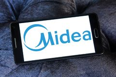 Midea Group logo. Logo of Midea Group on samsung tablet. Midea Group is a Chinese electrical appliance manufacturer, headquartered in Beijiao, Shunde, Foshan stock photo