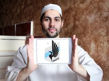 Minnesota United FC Soccer Club logo. Logo of Minnesota United FC Soccer Club on samsung tablet holded by arab muslim man. Minnesota United FC is an American Royalty Free Stock Photos
