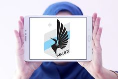 Minnesota United FC Soccer Club logo. Logo of Minnesota United FC Soccer Club on samsung tablet holded by arab muslim woman. Minnesota United FC is an American Royalty Free Stock Photography