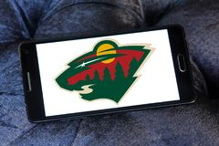 Minnesota Wild ice hockey team logo. Logo of Minnesota Wild ice hockey team on samsung mobile. The Minnesota Wild are a professional ice hockey team stock photo