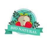 Logo mit einem Bild von geschnittenem rotem Apple und Victoria mit dem Aufschrift ` natürlichen Bio` Lizenzfreie Stockfotografie