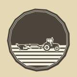 Logo mit einem Traktorpflügen Stockfotos