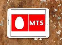 Mobile TeleSystems , MTS, logo. Logo of Mobile TeleSystems , MTS, on samsung tablet on wooden background. MTS is the largest mobile operator in Russia and CIS royalty free stock photos