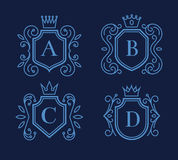Logo or monogram design with shields and crowns Stock Photo