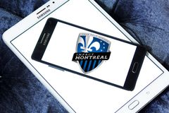Montreal Impact Soccer Club logo. Logo of Montreal Impact Soccer Club on samsung mobile. Montreal Impact is a Canadian professional soccer team Royalty Free Stock Images