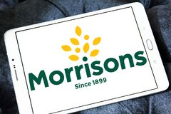 Morrisons Supermarkets chain logo. Logo of Morrisons Supermarkets chain on samsung tablet.  Morrisons, is the fourth largest chain of supermarkets behind Tesco Royalty Free Stock Photo