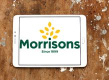 Morrisons Supermarkets chain logo. Logo of Morrisons Supermarkets chain on samsung tablet on wooden background.  Morrisons, is the fourth largest chain of Stock Photo