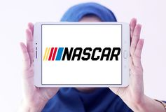 NASCAR Auto racing logo. Logo of NASCAR Auto racing on samsung tablet holded by arab muslim woman. National Association for Stock Car Auto Racing NASCAR is an royalty free stock photo