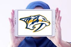 Nashville Predators ice hockey team logo. Logo of Nashville Predators club on samsung tablet holded by arab muslim woman. The Nashville Predators are a Stock Photography