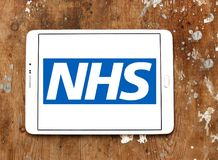 National Health Service , NHS , logo. Logo of National Health Service , NHS , on samsung tablet. The National Health Service NHS is the publicly funded national Stock Image