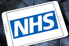 National Health Service , NHS , logo. Logo of National Health Service , NHS , on samsung tablet. The National Health Service NHS is the publicly funded national Stock Photo