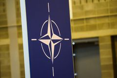 Logo of NATO North Atlantic Treaty Organization. 12.07.2018. BRUSSELS, BELGIUM. Logo of NATO North Atlantic Treaty Organization, during NATO SUMMIT 2018 royalty free stock photos