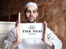 The ned hotel logo. Logo of the ned hotel on samsung tablet holded by arab muslim man.  The Ned is a hotel & members club in the City of London with nine Royalty Free Stock Images