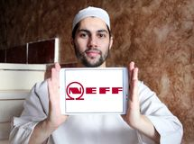 Neff company logo. Logo of Neff company on samsung tablet holded by arab muslim man. Neff is a German manufacturer of high-end kitchen appliances headquartered Stock Photography