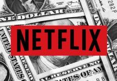 Netflix logo icon. Logo of netflix website on dollar bills money background stock photo