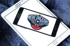 New Orleans Pelicans American basketball team logo. Logo of New Orleans Pelicans team on samsung mobile. The New Orleans Pelicans are an American professional Royalty Free Stock Image