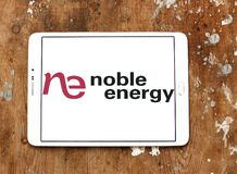 Noble Energy company logo. Logo of Noble Energy on samsung tablet on wooden background. Noble Energy, Inc., formerly Noble Affiliates, Inc., is an American Stock Photo