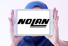 Nolan Helmets manufacturer logo. Logo of Nolan Helmets manufacturer on samsung tablet holded by arab muslim woman. Nolan Helmets SpA is an Italian motorcycle Royalty Free Stock Images