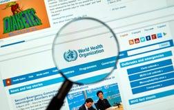Logo och webbplats för vård- organisation för värld royaltyfri bild