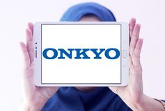 Onkyo Corporation logo. Logo of Onkyo Corporation on samsung tablet holded by arab muslim woman. Onkyo is a Japanese consumer electronics manufacturer Stock Image
