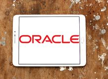 Oracle logo. Logo of oracle company on samsung tablet on wooden background Stock Photos