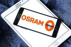 Osram lighting company logo. Logo of Osram lighting company on samsung mobile. Osram Licht AG is a multinational lighting manufacturer headquartered in Munich royalty free stock photo