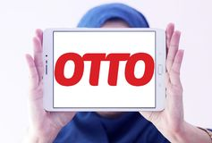 OTTO retailer logo. Logo of OTTO retailer on samsung tablet holded by arab muslim woman. OTTO is a broad based retailer that sells its own products alongside Stock Images