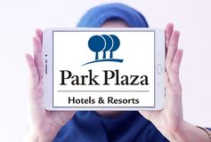 Park Plaza Hotels & Resorts logo. Logo of Park Plaza Hotels and Resorts on samsung tablet holded by arab muslim woman. Park Plaza Hotels & Resorts is a worldwide Royalty Free Stock Image