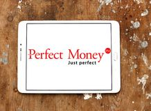 Perfect Money bank logo. Logo of Perfect Money payment system on samsung tablet on wooden background Royalty Free Stock Image