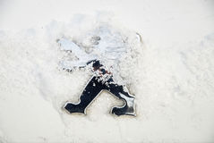 Logo of Peugeot on car during snowy weather Royalty Free Stock Photography