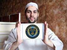 Philadelphia Union Soccer Club logo. Logo of Philadelphia Union Soccer Club on samsung tablet holded by arab muslim man. The Philadelphia Union is an American Royalty Free Stock Photo