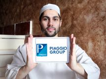 Piaggio motor vehicle manufacturer logo. Logo of Piaggio company on samsung tablet holded by arab muslim man. Piaggio is an Italian motor vehicle manufacturer Stock Photography