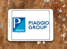 Piaggio motor vehicle manufacturer logo. Logo of Piaggio company on samsung tablet on wooden background. Piaggio is an Italian motor vehicle manufacturer, which Stock Photo