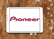 Pioneer Corporation logo. Logo of Pioneer Corporation on samsung tablet on wooden background. is a Japanese multinational corporation that specializes in digital Stock Photos
