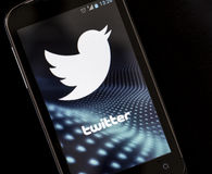 Logo of popular social media website Twitter on smart phone screen Stock Photo