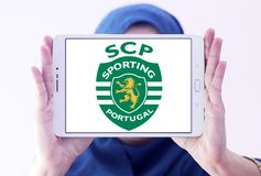 Sporting Lisbon football club logo. Logo of Portuguese Sporting Lisbon football club on samsung tablet holded by arab muslim woman Royalty Free Stock Photos