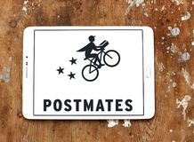 Postmates Goods delivery company logo. Logo of Postmates company on samsung tablet. Postmates is a logistics company that operates a network of couriers who stock photo